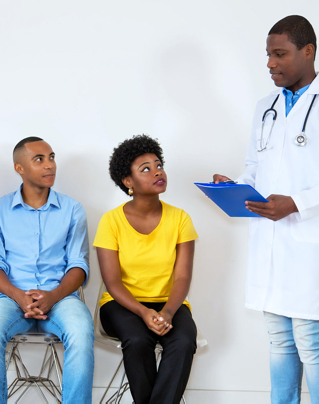 doctor talking to man and woman